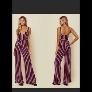 Blue life burgundy, black, and white jumpsuit.